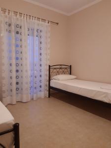Ένα ή περισσότερα κρεβάτια σε δωμάτιο στο Valedina Rooms