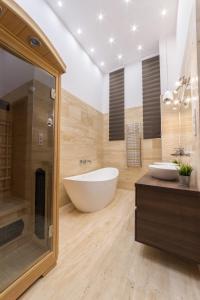 Ein Badezimmer in der Unterkunft Presidential Suite Spa
