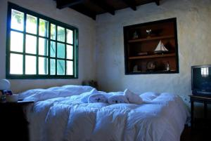 A bed or beds in a room at HotelArte