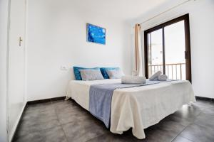 A bed or beds in a room at Dunas 4
