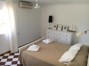 A bed or beds in a room at Son Veri D'Abaix