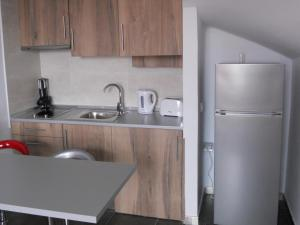 A kitchen or kitchenette at COSTA ADEJE SUITE - SIAM PARK AREA