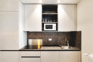A kitchen or kitchenette at Maggiore Residence Flats