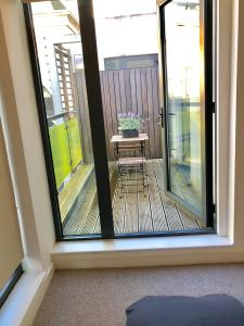 A balcony or terrace at City Short Stays Aldgate East Studios