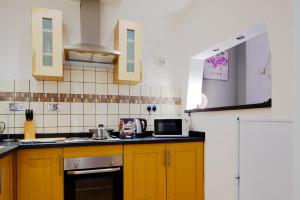 A kitchen or kitchenette at Apartment on the Parade