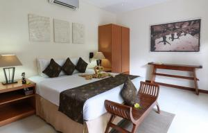 A bed or beds in a room at Villa Coco Bali