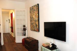 A television and/or entertainment center at Canal de l'Ourcq Flat
