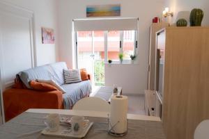 Zona de estar de Central Apartment Near Martianez Beach with Balcony