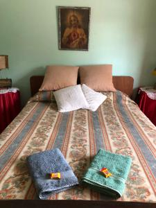 A bed or beds in a room at Las Abuelas