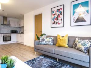 A seating area at Tudors Canal Side Apartments Two Bedrooms