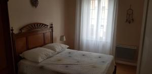 A bed or beds in a room at LISABEL