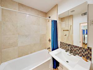 A bathroom at Centrally Located Modern Condo Condo