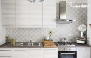 Cucina o angolo cottura di PizzaSleep -apartment-