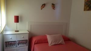 A bed or beds in a room at Piso moderno en Enix. Calle Roquetas de Mar n. 12 piso 5 F