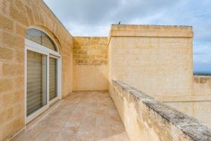 A balcony or terrace at Entire Villa - Gemini Farmhouse, Nadur Gozo