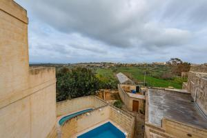 A view of the pool at Entire Villa - Gemini Farmhouse, Nadur Gozo or nearby