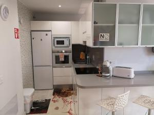 A kitchen or kitchenette at Marina Suite