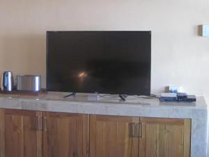 A television and/or entertainment centre at Caimeo Beach Resort