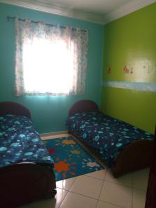 A bed or beds in a room at Maria.