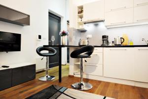 Кухня или мини-кухня в Tree Park Apartment