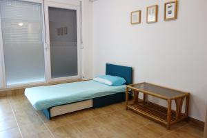 A bed or beds in a room at Clementine