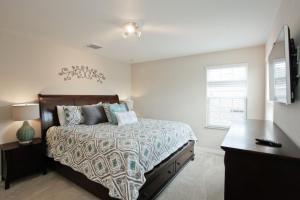 Un ou plusieurs lits dans un hébergement de l'établissement Veranda Palms 2600