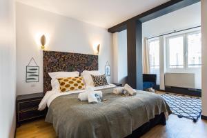 Tempat tidur dalam kamar di CMG Champs Elysées / 4 Boetie 4DF