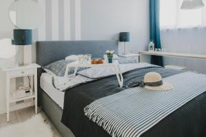 A bed or beds in a room at Feriatum Rent Centrum