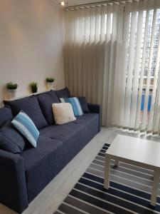A seating area at Al.JP 26 Coser Apartamenty Centrum