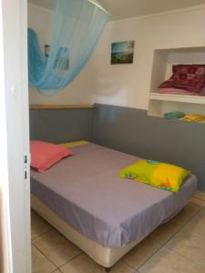 A bed or beds in a room at Clin D'oeil De L'ocean