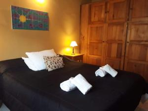 A bed or beds in a room at Dharma