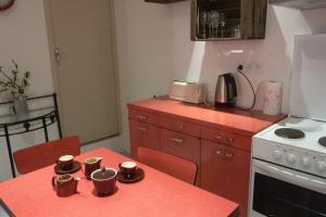 Cuisine ou kitchenette dans l'établissement Harmonies'son