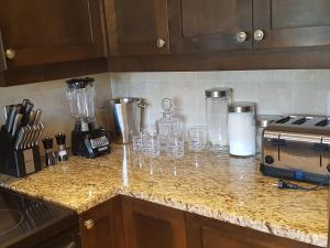 A kitchen or kitchenette at Villa Del Mar Resort Luxury 2 Bedroom Apartment
