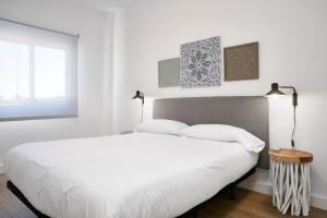 A bed or beds in a room at Amador de los Rios