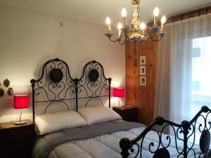 Voodi või voodid majutusasutuse Casa Malerba toas
