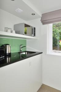 A kitchen or kitchenette at SO Arch Aparthotel