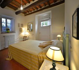 A bed or beds in a room at In Versilia