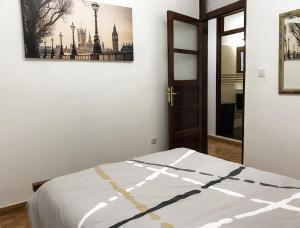 A bed or beds in a room at Cosy flat in LAS CANTERAS