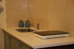 A kitchen or kitchenette at CentAmore