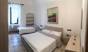 A bed or beds in a room at Appartamento Lidia
