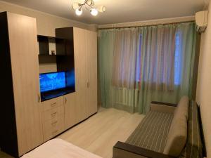 Кровать или кровати в номере Apartments On Stabilnaya