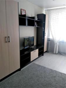 A television and/or entertainment center at Apartment on Nazarbaeva street