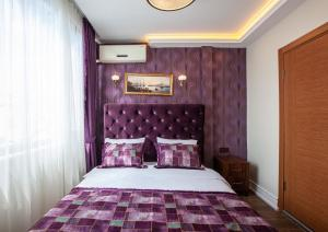 A bed or beds in a room at Rose Mansion by Otantik Suites