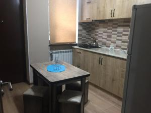 A kitchen or kitchenette at Meidani Apartment