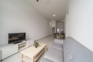 A television and/or entertainment center at OYO Home 790 Premium 2BR Vue Residences