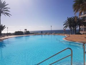The swimming pool at or near Seaside apartment in Playa del Aguila