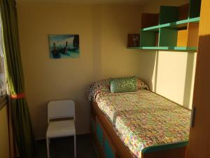 A bed or beds in a room at Seaside apartment in Playa del Aguila