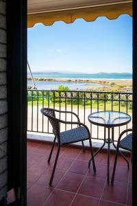 A balcony or terrace at Koronisia Apartments