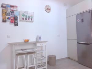 A kitchen or kitchenette at La Caleta de Cadiz