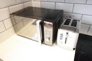 A kitchen or kitchenette at Willow Serviced Apartments - The Walk 2